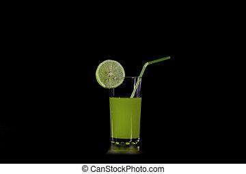 a slice of citrus fruit on a glass orange