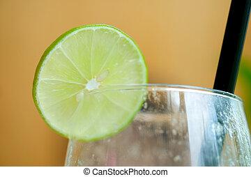 A slice of lemon decoration on glass