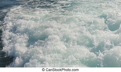 A slow motion Blue ocean and trail, closeup.
