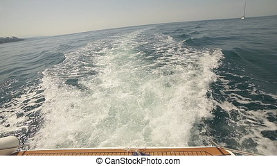 A slow motion view of the wake behind a sports boat at sea....