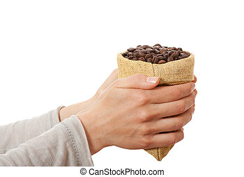 A small bag of coffee beans in female hands