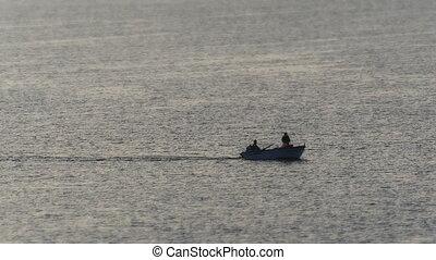 a small boat at sea at sunrise 4k
