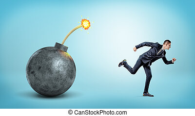 A small businessman on blue background running away from a giant bomb with a lit fuse.