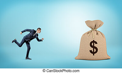 A small businessman running to a giant closed sack with a dollar sign on it.