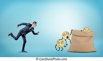 A small businessman running to a large full sack where many coins with arms and legs are getting in.