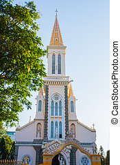 A small Catholic Church which is located near the road in the capital of Vietnam.