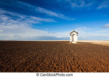 A small chapel in the middle of fields