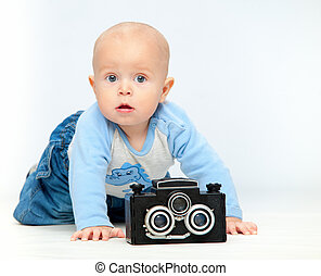 A small child and a camera.