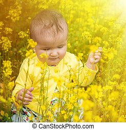 A small child playing in the field