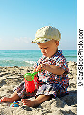a small child playing on the shore of the sea