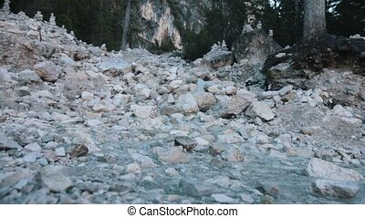 A small creek streams through the rocks. Close up