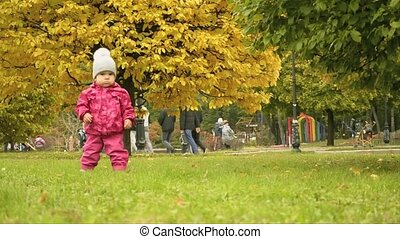 a small girl dancing in the park