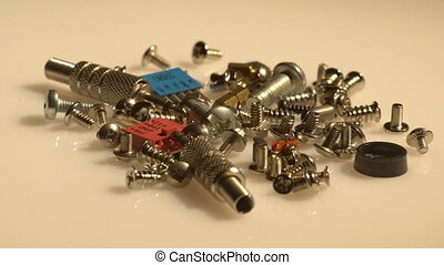 A small heap of computer screws