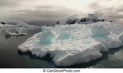 A small iceberg floating in waters of Antarctica.