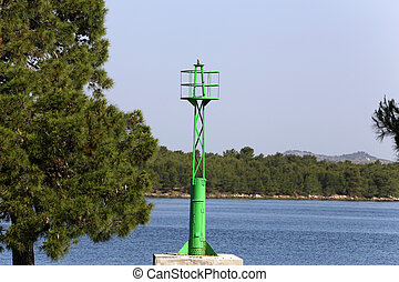 A small lighthouse on the strait coast