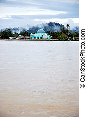 a small mosque on the banks of the river Malinau, Indonesia