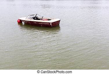 small old boat in a lake
