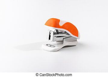 A small orange stapler isolated on a white background. Close-up. Copy space. Space for text