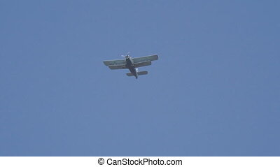 A small plane in blue sky