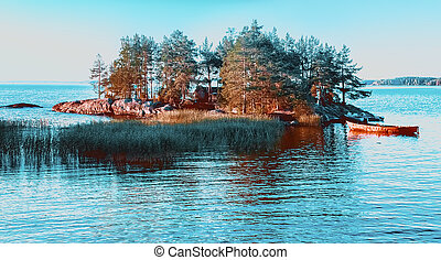 A Small Remote Island Among The Blue Water of Lake