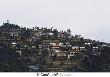 A small remote village of Nepal surrounded by hills