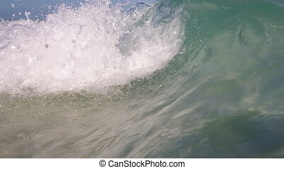 A small rip curl wave - A wide shot of a small rip curl ...