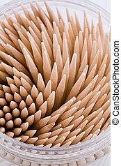 A small round box of toothpicks macro