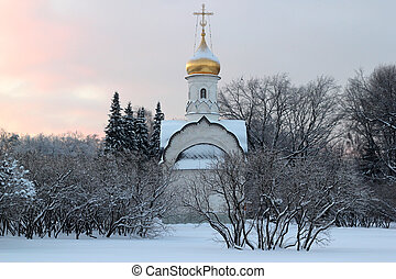 a small russian church at sunset