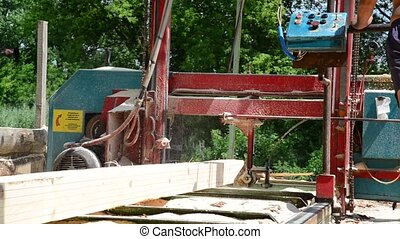 small sawmill on the outside - a small sawmill on the...