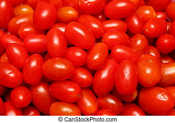 small shiny tomato for red background