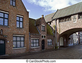 A small street in Bruges, Belgium. - A small street in ...