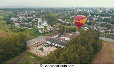 A small village - a balloon flying in the sky - Suzdal,...