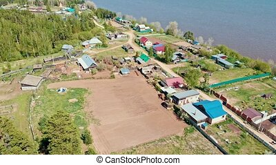 A small village on the on the riverbank. Aerial shot