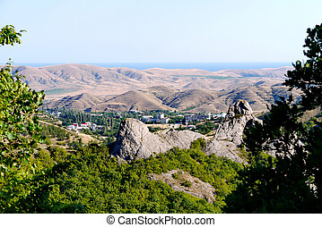 A small village surrounded by boundless mountains on the background of the Black Sea