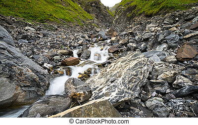 small waterfall in a mountain valley