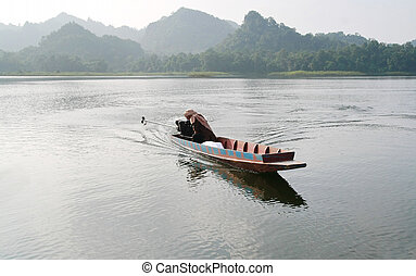 a small wood boat in lake, Thailand