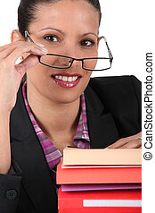 a smart business woman with documents