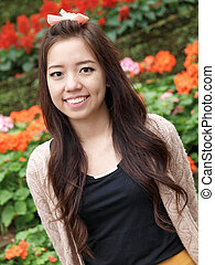 A smile of Asia beautiful girl on a colorfull flower background