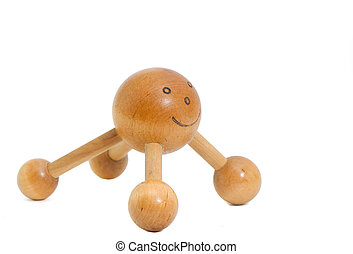 a smiley wooden massager for the back