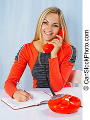 a smiling blonde in red dress with phone