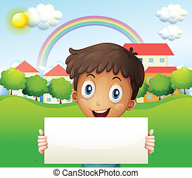 A smiling boy holding an empty cardboard