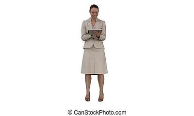 A smiling businesswoman using a tablet