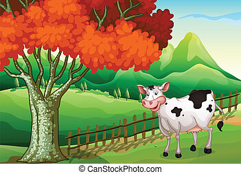 A smiling cow near the big tree