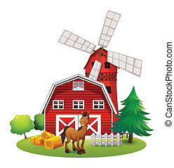 A smiling horse outside the red barnhouse with a windmill
