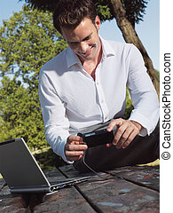 A smiling man with laptop