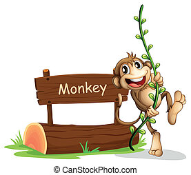 A smiling monkey beside a signage
