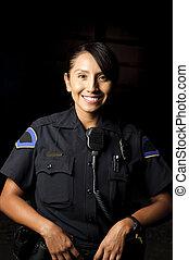 police officer - a smiling police officer posing for her...