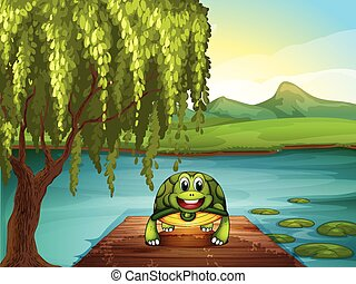 A smiling turtle along the pond