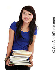 A smiling woman holding books