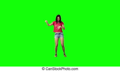 A smiling woman is dancing and having fun